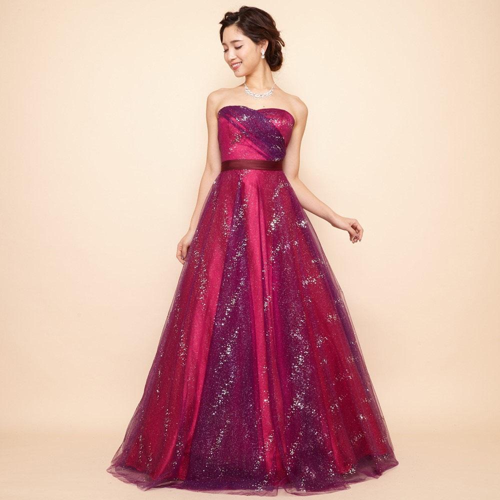 エキゾチックなフーシャパープルの色合いとグリッター装飾がキラキラのボリュームチュールドレス