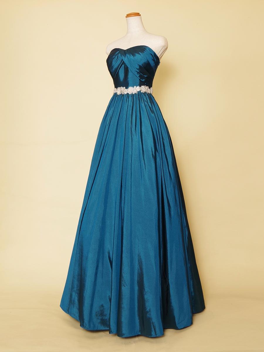 海のような美しく濃いエメラルドブルーカラーが涼しげで気品を感じさせるロングドレス