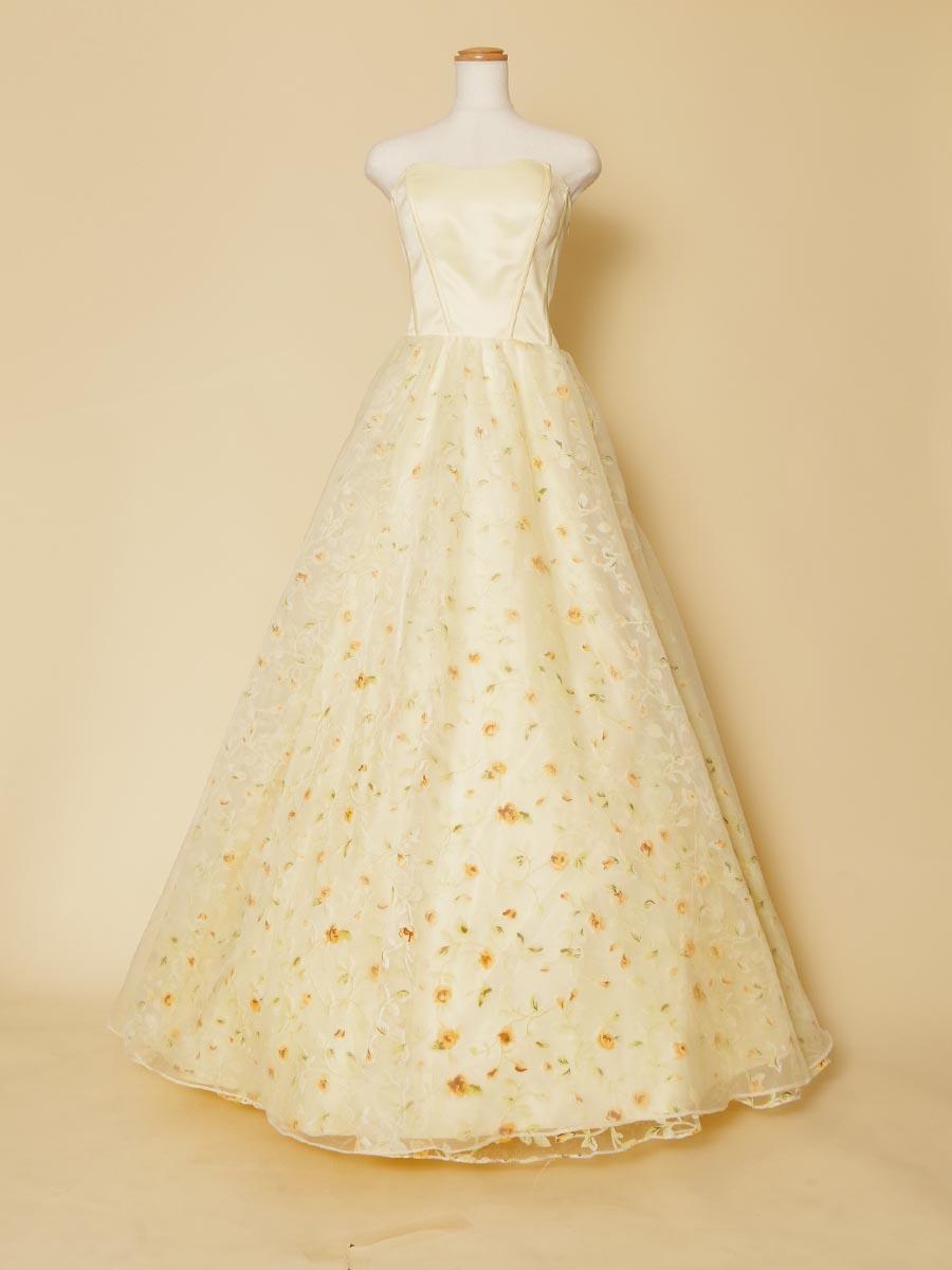イエローフラワープリントをスカート全体に広げたお花畑のようなボリュームロングドレス