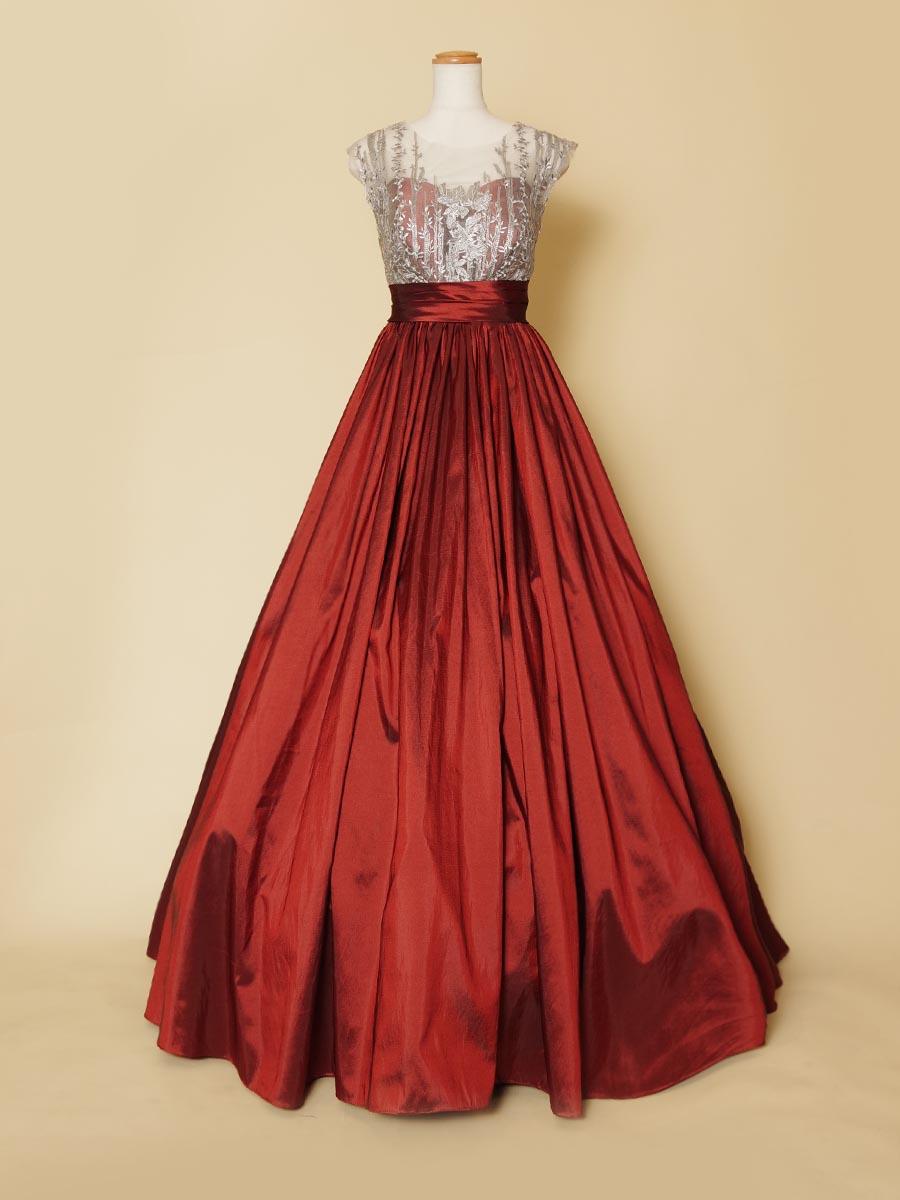 コッパーカラーの色合いを持たせたタフタの光沢が美しい胸元シルバー装飾デザインのロングドレス