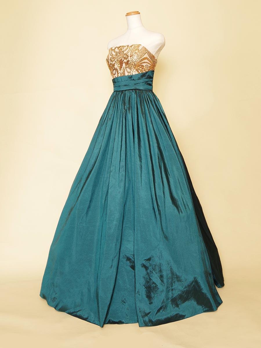 ディープエメラルドグリーンタフタスカートに胸元ゴールドスパンコールを組み合わせたカラーロングドレス