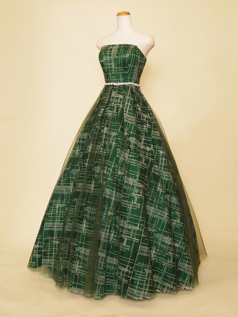 ボックス型のグリッターラインがデザイン性の高さを感じさせるディープグリーンステージロングドレス