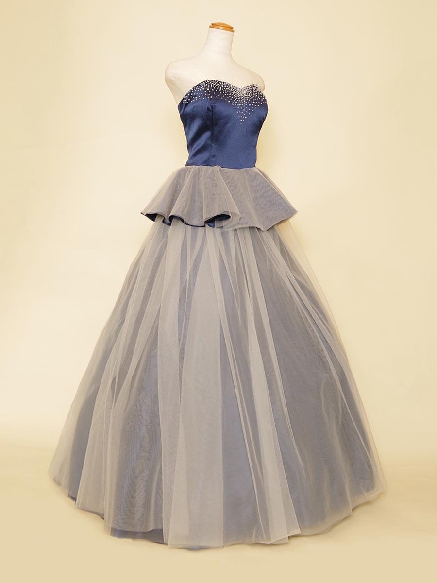 2層レイヤーデザインのキラキラ胸元ストーンが目を引くステージボリュームドレス