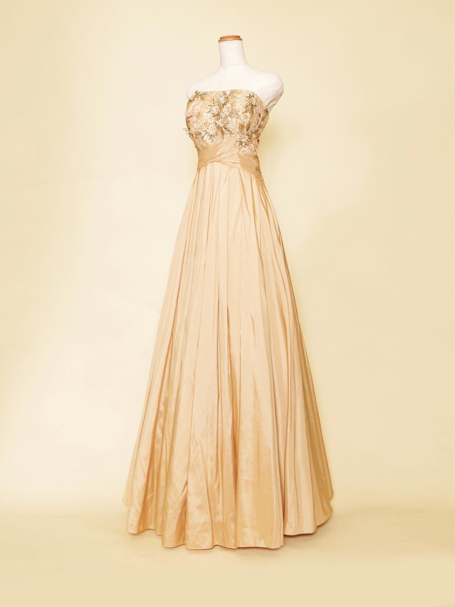 ベージュイエローカラーが落ち着いた可憐さを演出したウエストクロスデザインのスレンダータフタドレス