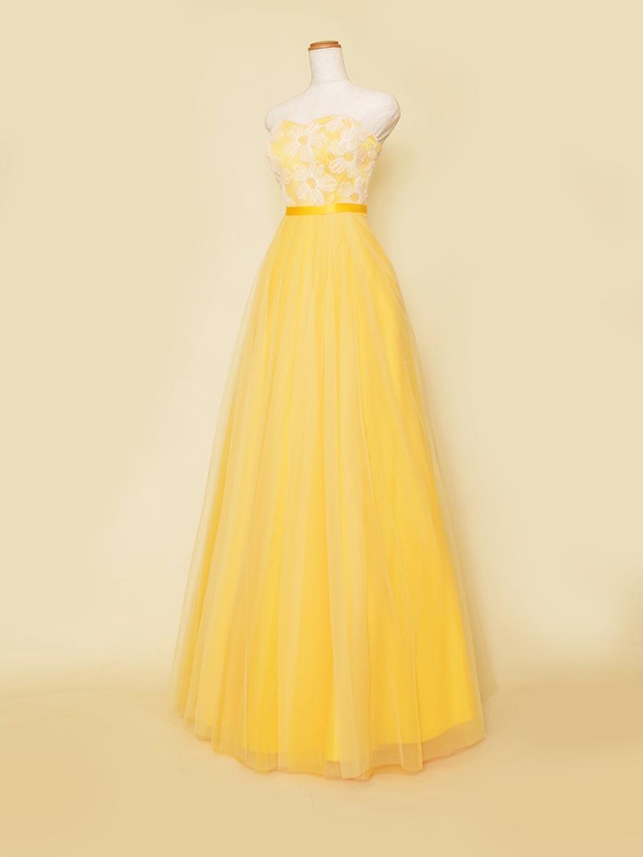 スッキリAラインシルエットのハツラツイエローカラーのチュールスカートロングドレス