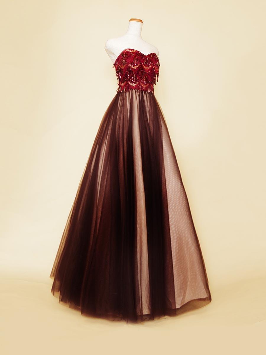 ベリーダンスの衣裳から着想を得てデザインされたワインレッドブラウンAライン演奏会ドレス