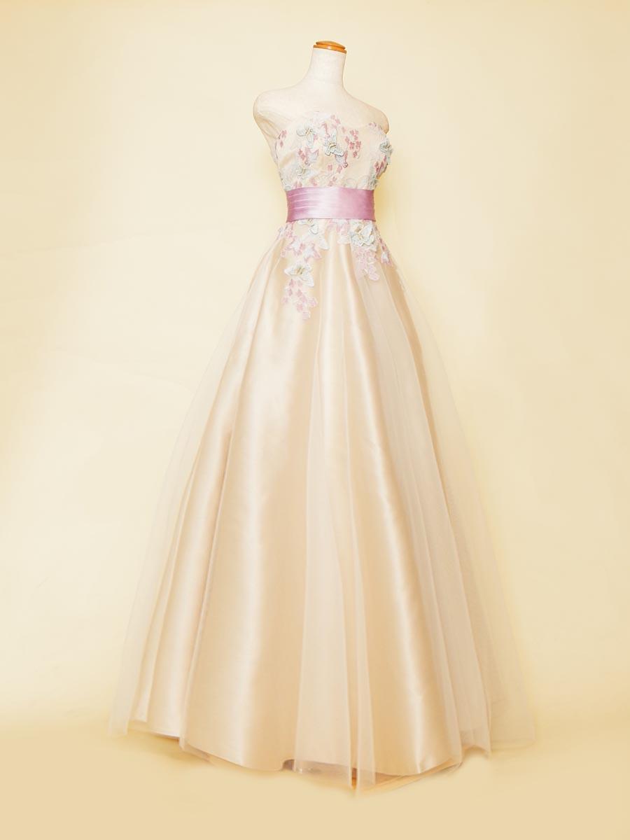 ベージュベースにパープルカラーのお花刺繍を組み合わせたAラインステージドレス