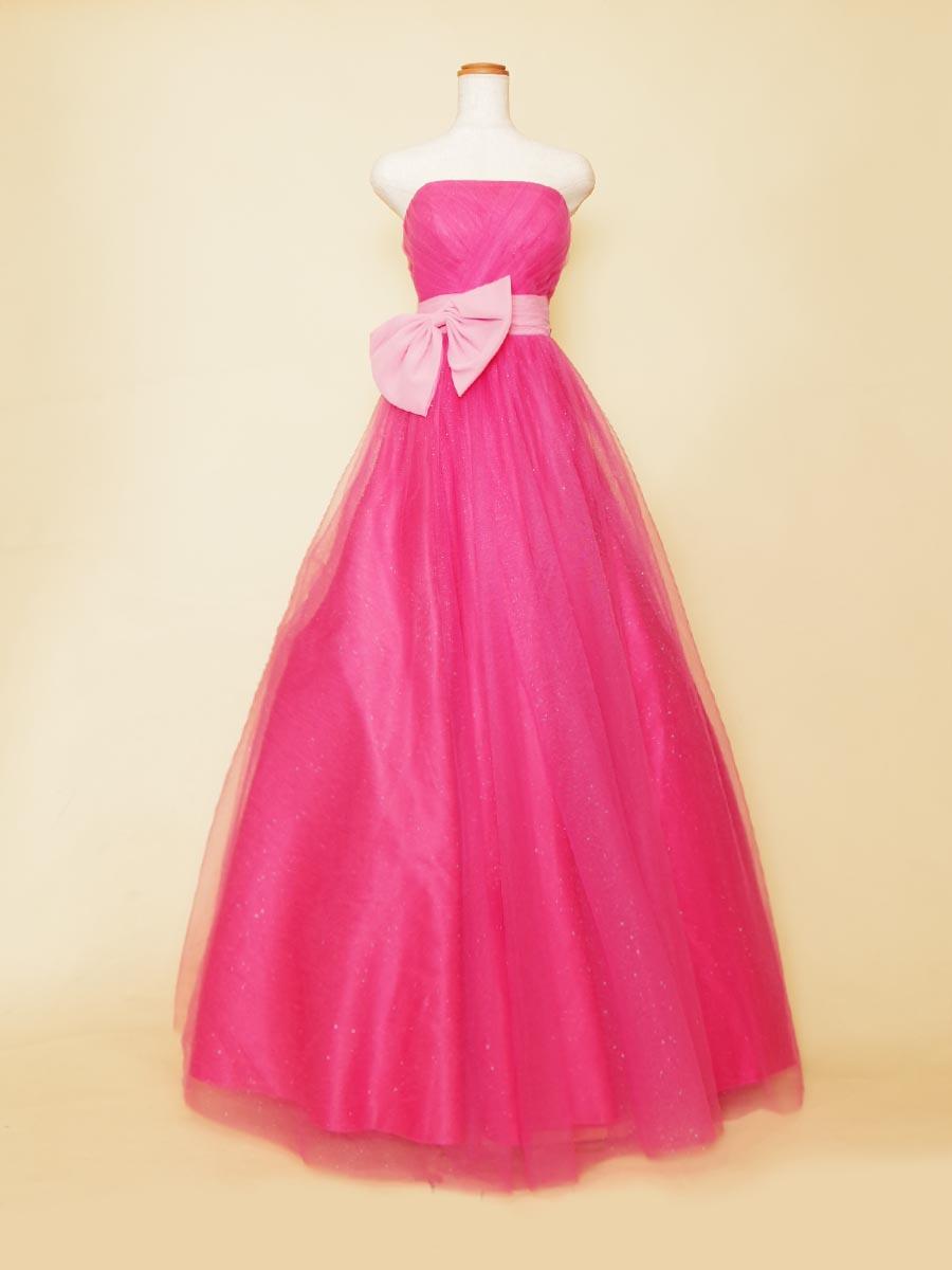 コーラルピンクカラーのふんわりベルラインのリボンデザインステージドレス